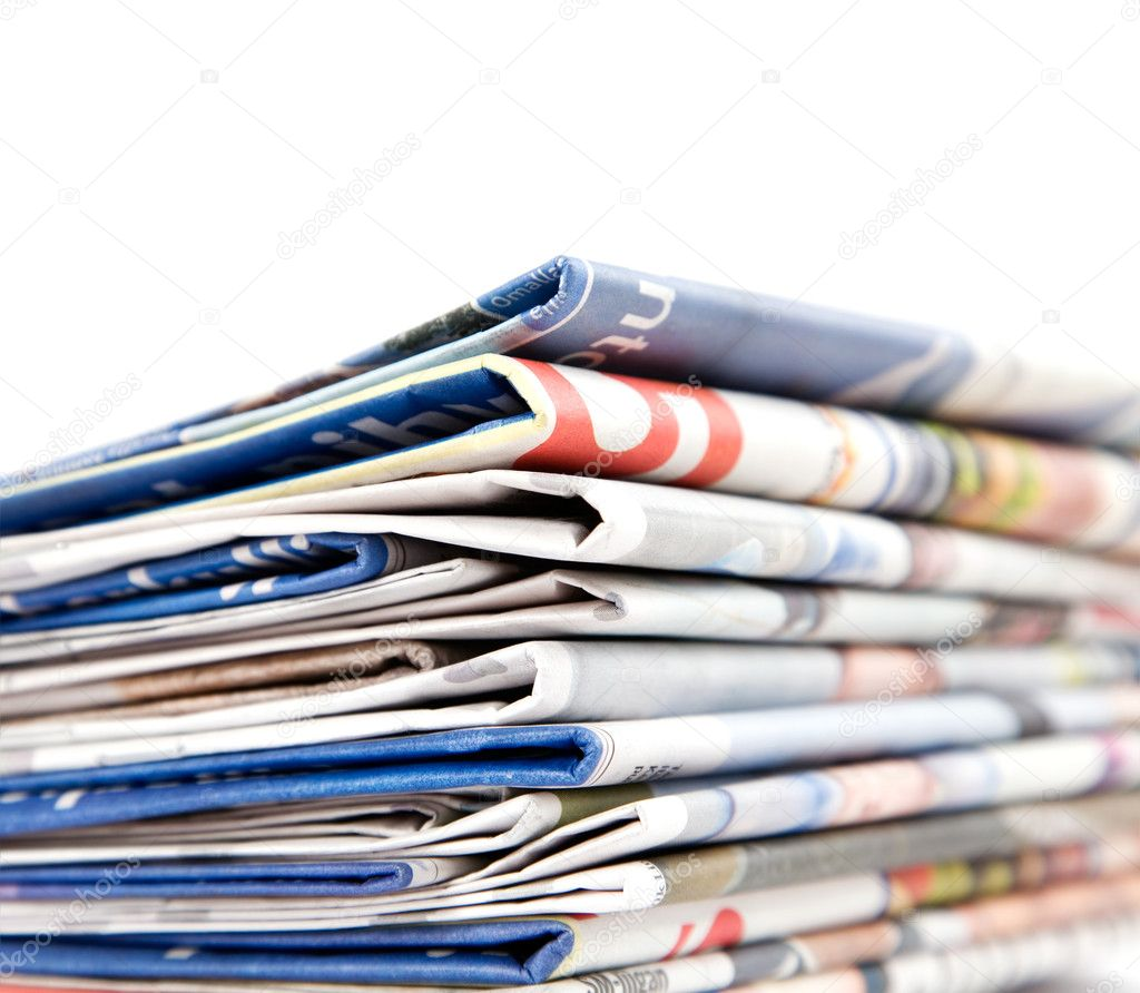 Stack of newspapers on white background  Stock Photo #6287358