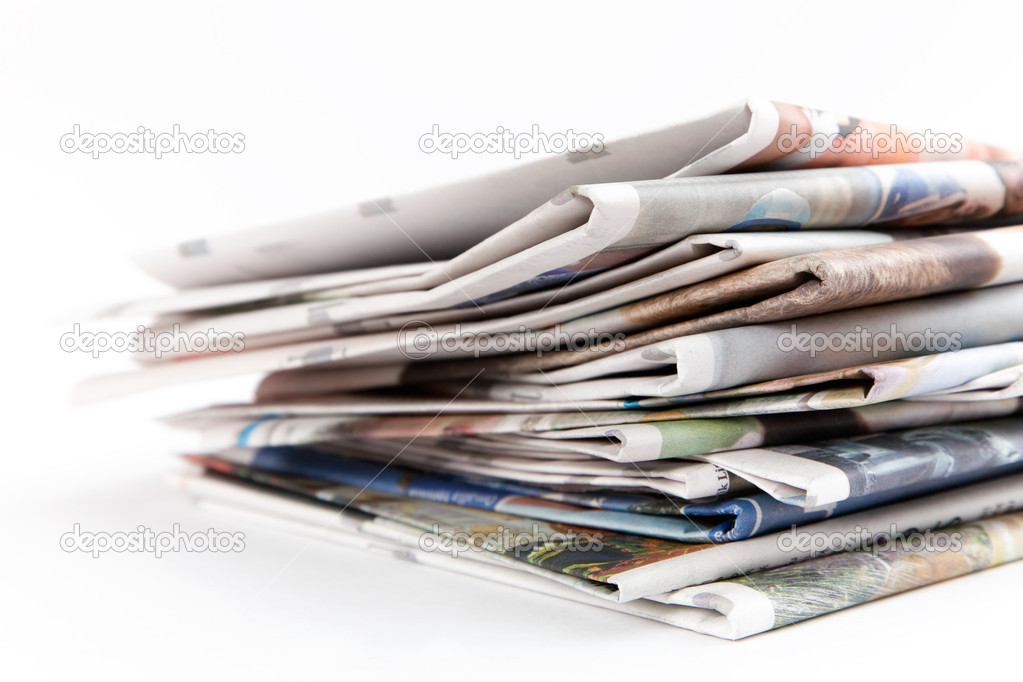Stack of newspapers on white background — Stock Photo #6287364