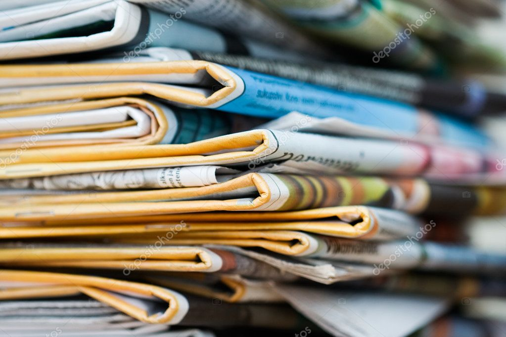 Big pile of newspapers, focus in front — Stock Photo #6287735