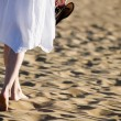 Woman walking on the beach — Stock Photo
