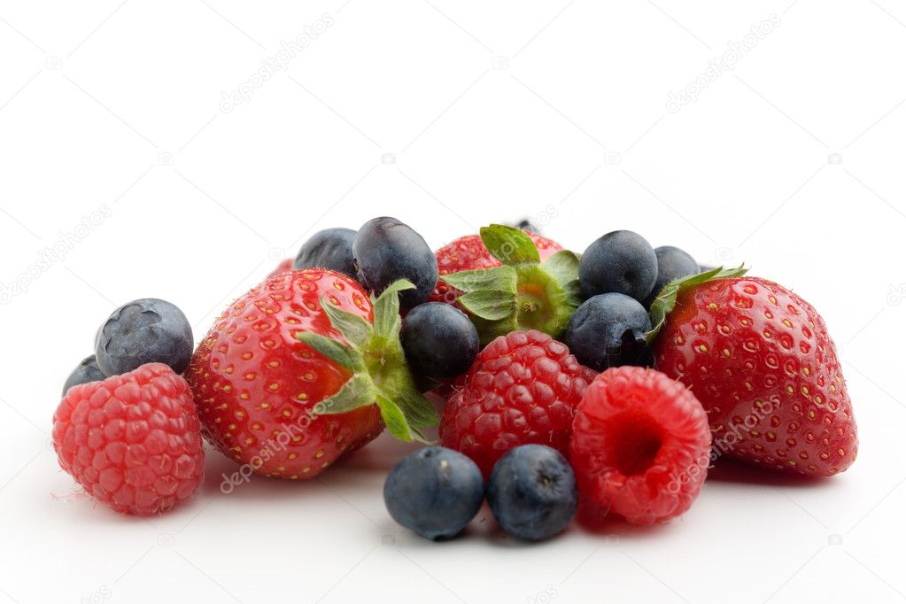 Strawberries, raspberries and blueberries on white  Stock Photo #6336091