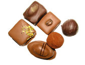 Assorted chocolate candies isolated on white background — Stock Photo