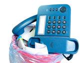 Old-fashion phone in rubbish bin — Stock Photo