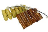 Cannella e arachidi forcine isolati su bianco — Foto Stock