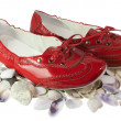 Red lady ballet flat shoes and seashells isolated on white — Lizenzfreies Foto