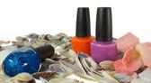 Three nails polish and seashells on white background — Stock Photo