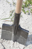 New shovel in a sand, close up — Stock Photo