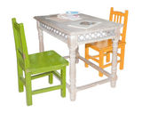 Nice children colorful furniture: table and two different chairs — Stock Photo