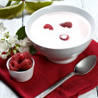 Raspberry with yogurt — Stock Photo