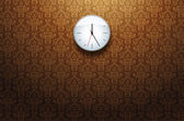 Clock on the wall in the room — Stock vektor