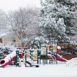 Kids playground in winter snow — Stock Photo