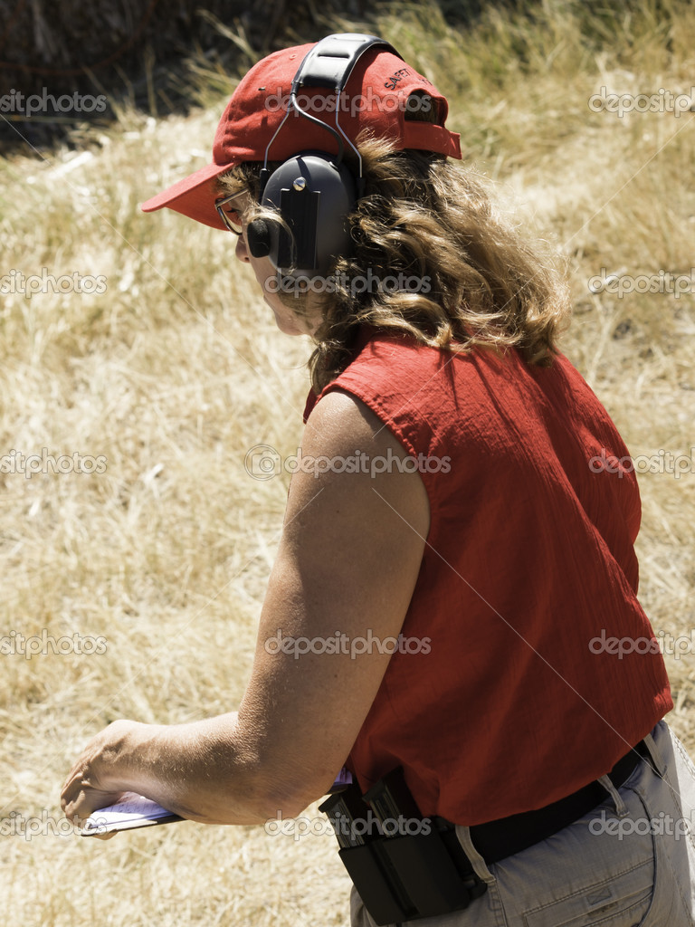 Woman practicing target shooring.  Stock Photo #6729904