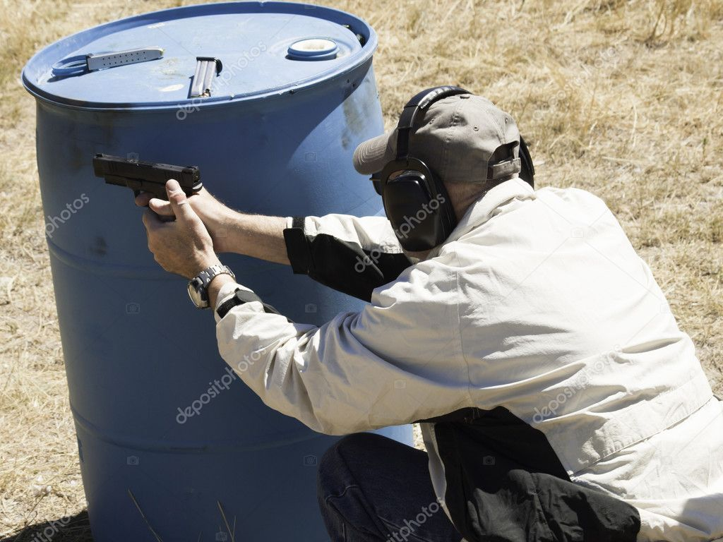 Man practicing target shooring.  Stock Photo #6729981