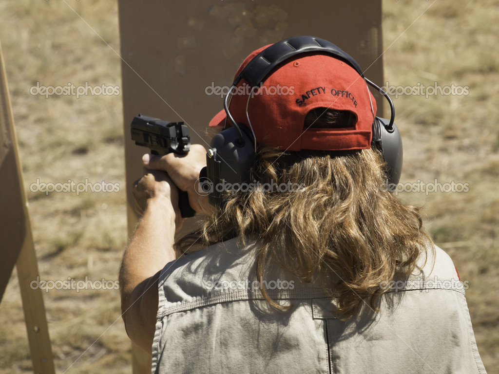 Woman practicing target shooring.  Stock Photo #6730112