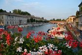 Peschiera del garda among the flowers — Stock Photo