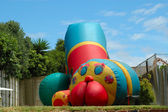 Bouncing castle for jumping kids — Stock Photo
