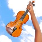 Violin in hand — Stock Photo