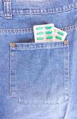 Pills in pocket — Stock Photo