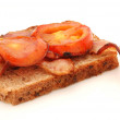 Bacon and tomatoes on bread — Stock Photo