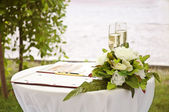 Wineglass,flowers and register book — Stock Photo