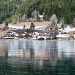 Village at the frozen mountain lake — Stock Photo #6112410