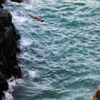 Stock Photo: Cliff diver