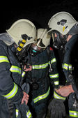 Firemen in respirators — Stock Photo