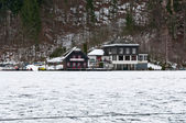 Hotel on the mountain lake in winter — Stock Photo