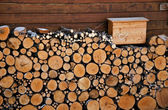 Firewood stock near Austrian house — Stock Photo