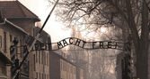 Auschwitz sign in sepia — Stock Photo