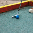 Putting at mini golf leisure facility — Stock Photo #6244911