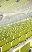 Empty plastic seats at stadium, open door sports arena — Stock Photo