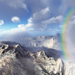 Stock Photo: Rainbow over volcanic landscape