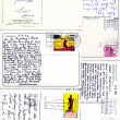 Stock Photo: Varoius stamps and hand writings on vintage postcards