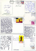 Varoius stamps and hand writings on vintage postcards — Stock Photo