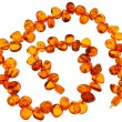 Amber necklace on white background - Foto Stock