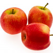 Three red ripe apples on white background — Stock Photo