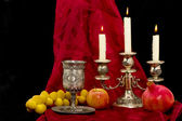 Cup fruits and candles — Stock Photo