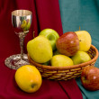 Cup and apple basket - Stock Photo