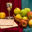 Matzo cup and apple basket — Stock Photo