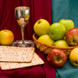 Matzo cup and apple basket - Stock Photo