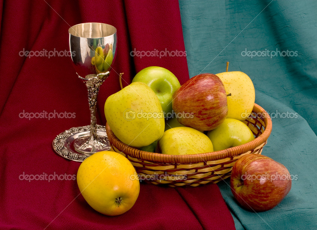 Cup and apple basket on colour fabrics — Stock Photo #6555935