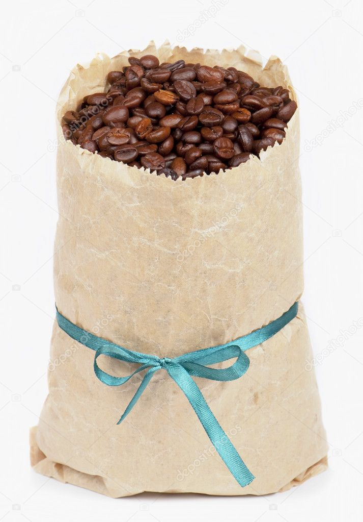 Coffee grains in paper package with a tape on white background — Stock Photo #6284465