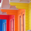 Colourful beach huts - Stock Photo