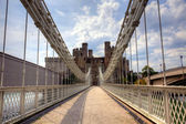 Suspension bridge and castle — Stock Photo