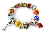 Beads and gems bracelet isolated in white — Stock Photo