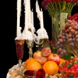 Arranged table with candles, fruits, nuts and flowers — Stock Photo