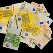 Stock Photo: Different euro bills isolated in black