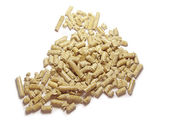 Wood pellets background close up. Isolated in white — Stock Photo