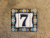 Number seven in a ceramic tile on street — Stok fotoğraf
